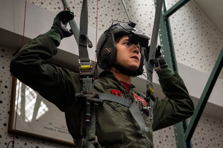 U.S. Air Force Capt. Daniel Hayduchok, 480th Fighter Squadron pilot, uses a virtual-reality parachute system during Survival, Evasion, Resistance, and Escape training at Spangdahlem Air Base, Germany, March 6, 2020. SERE training teaches pilots how to safely hit the ground in a parachute and troubleshoot problems in an emergency scenario. (U.S. Air Force photo by Senior Airman Valerie R. Seelye)