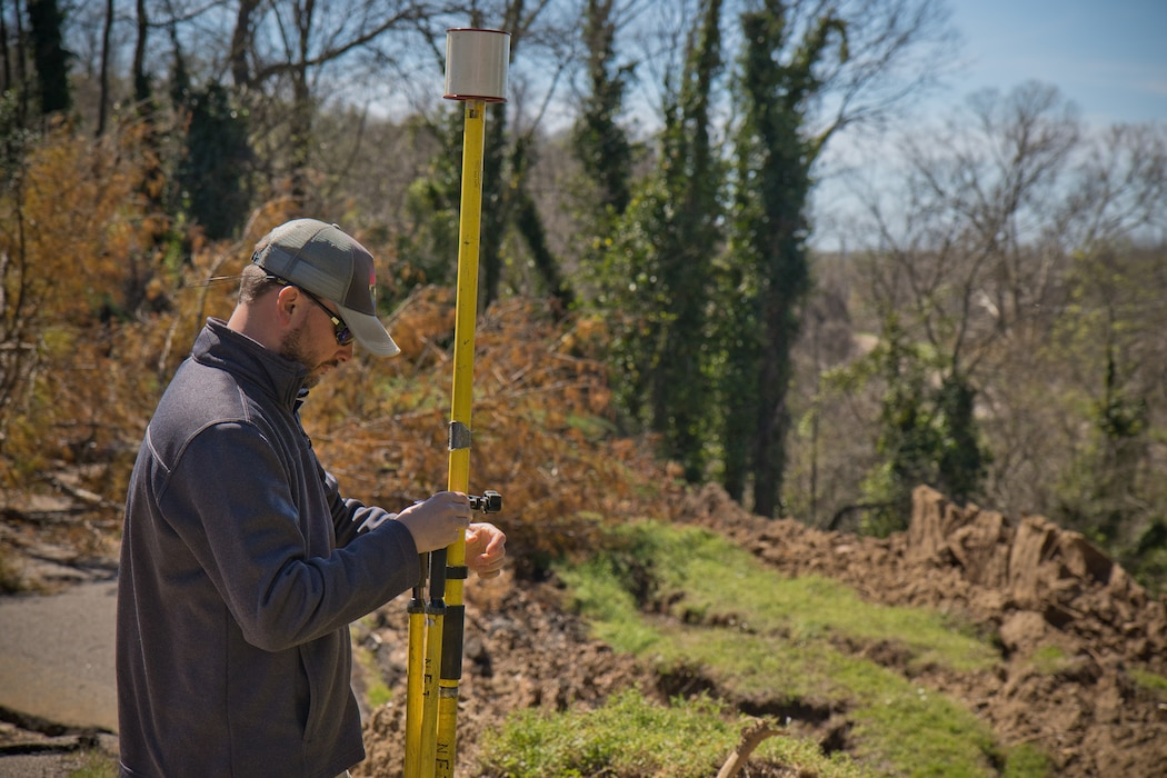 Daniel Hickman, a civil engineering technician and member of the U.S. Army Engineer Research and Development Center's Coastal and Hydraulics Laboratory's Unmanned Aircraft Systems Team, sets up equipment for a UAS flight over a landslide at the Vicksburg National Military Park