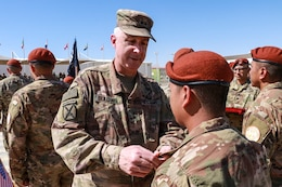 Maj. Gen. John P. Sullivan, Commanding general of the 1st Theater Sustainment Command presents a Soldier from the 1st Battalion, 294th Infantry Regiment, Guam National Guard, with the MFO Medals during the Transfer of authority ceremony on South Camp, in Sharm el-Sheikh, Egypt, March 8, 2020. For the past 9 months, the 1-294th have served as the 66th rotational U.S. Army unit in support of the MFO peacekeeping mission.