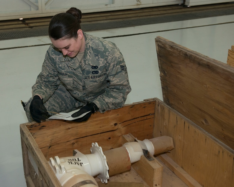 Senior Airman Megan Murray, customer service representative assigned to the 103rd Logistics Readiness Squadron checks an aircraft part for defects March 1, 2020, on Bradley Air National Guard Base, East Granby, Conn. The supply component of the 103rd LRS is broken down into three sections: clothing mobility, the warehouse, and the Mission Support Liaison. (U.S. Air National Guard photo by Senior Airman Sadie Hewes)