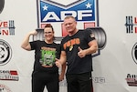 Kathleen Webb with her coach, DLA Aviation employee Terry Baldwin, at the 'Nightmare on Deadlift Street' powerlifting competition in October 2019.