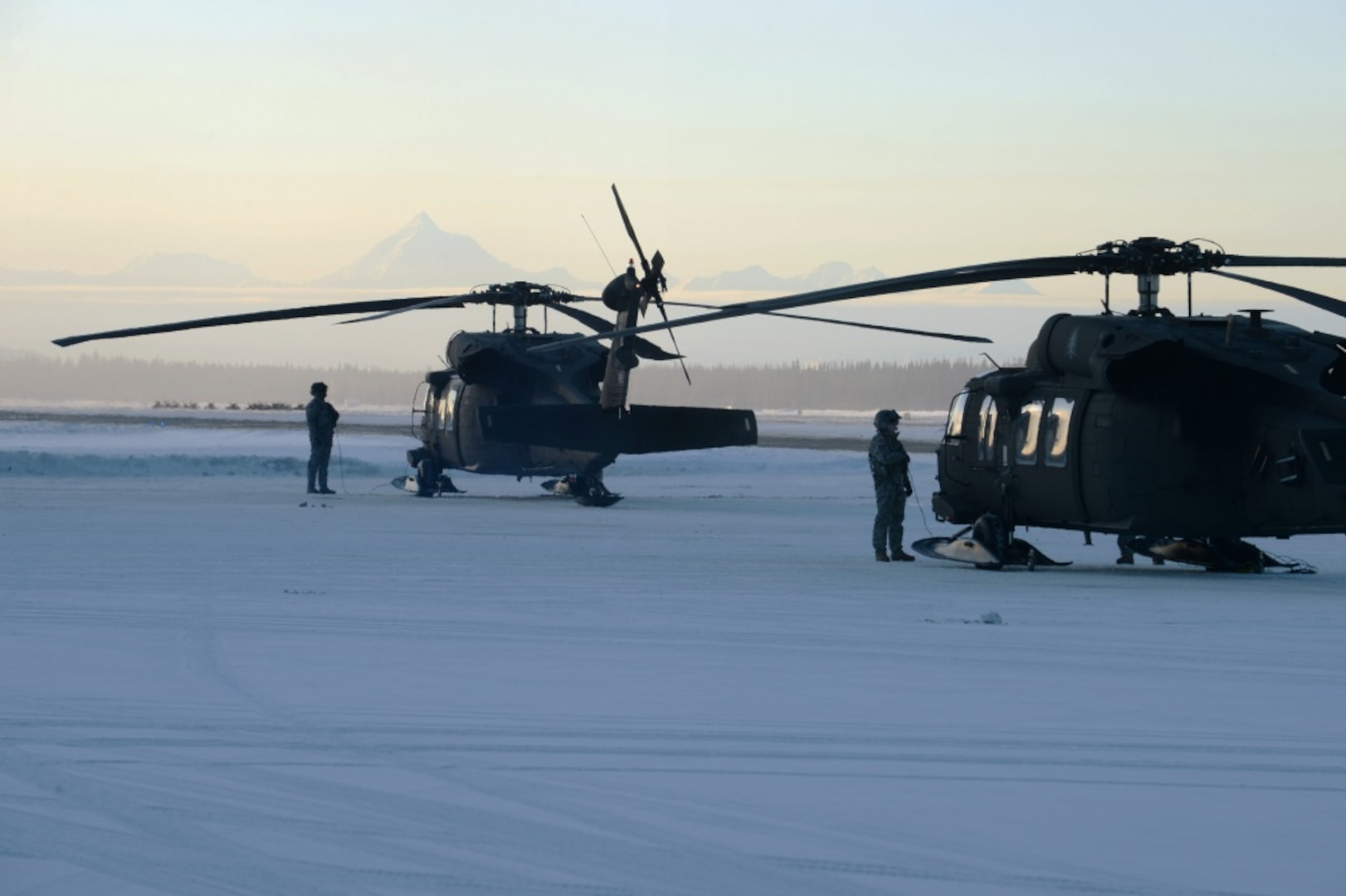 Crew chiefs for the NHARNG's 1/169th General Support Aviation Batallion, stand by their Black Hawks as they try to warm in the sub-zero temperatures at Eielson Air Base, Alaska on Feb. 26.