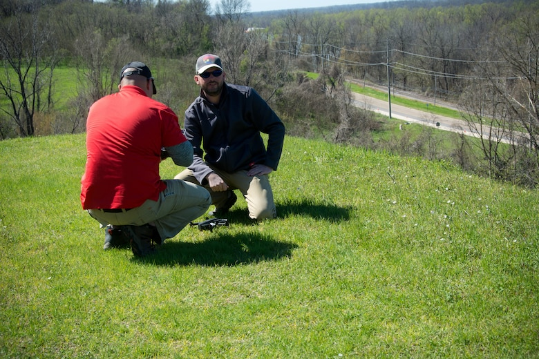 Daniel Hickman and David Nguyen, members of the U.S. Army Engineer Research and Development Center's Coastal and Hydraulics Laboratory's Unmanned Aircraft Systems Team, prepare a UAS for flight over a landslide at the Vicksburg National Military Park.