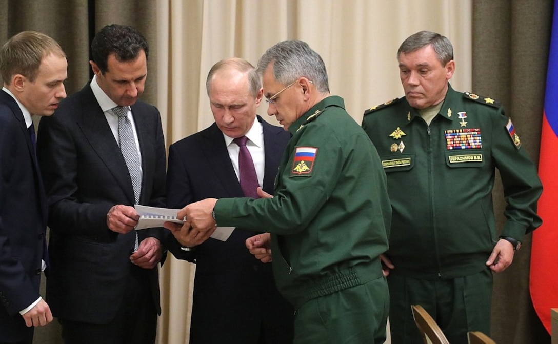 Syrian president Bashar al-Assad (second  from  left), Russian president Vladimir Putin (center), Russian minister of defense Sergei Shoigu (second from right), and chief of the general staff of the Russian Federation armed forces Valery Gerasimov (right) meet 21 November 2017 in Sochi, Russia, to discuss Russian support for operations in Syria.