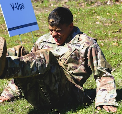 Army Pfc. Maximilliano Estrada of the 71st Expeditionary Military Intelligence Brigade performs V-ups during the obstacle course portion of the Texas Military Department's 2020 Best Warrior Competition March 5, 2020, at Camp Swift near Bastrop, Texas. Estrada, who began bleeding halfway through the event, refused to stop and completed the course.