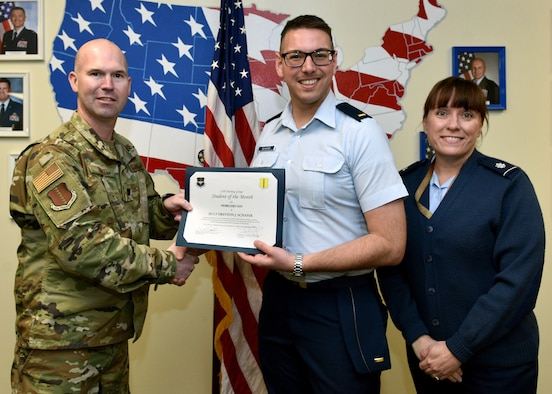 U.S. Air Force Lt. Col. Kevin Boss, 17th Training Group director of operations, presents the 315th Training Squadron Officer Student of the Month award to 2nd Lt. Dreyton Schafer, 315th TRS student, at Brandenburg Hall on Goodfellow Air Force Base, Texas, February 6, 2020. The 315th TRS' vision is to develop combat-ready intelligence, surveillance and reconnaissance professionals and promote an innovative squadron culture and identity unmatched across the U.S. Air Force. (U.S. Air Force photo by Airman 1st Class Robyn Hunsinger)
