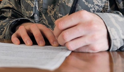Soldier signing lease