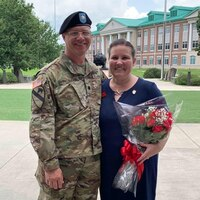 Lori Rozhon with her husband, Lt. Col. Chris Rozhon, at his change of command ceremony on Fort Stewart in June 2019. The couple came to the 1st Theater Sustainment Command in August 2019. (Contributed)