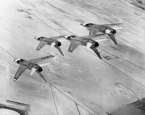 An aerial view of four Thunderbird jets performing over Hill Air Force Base.