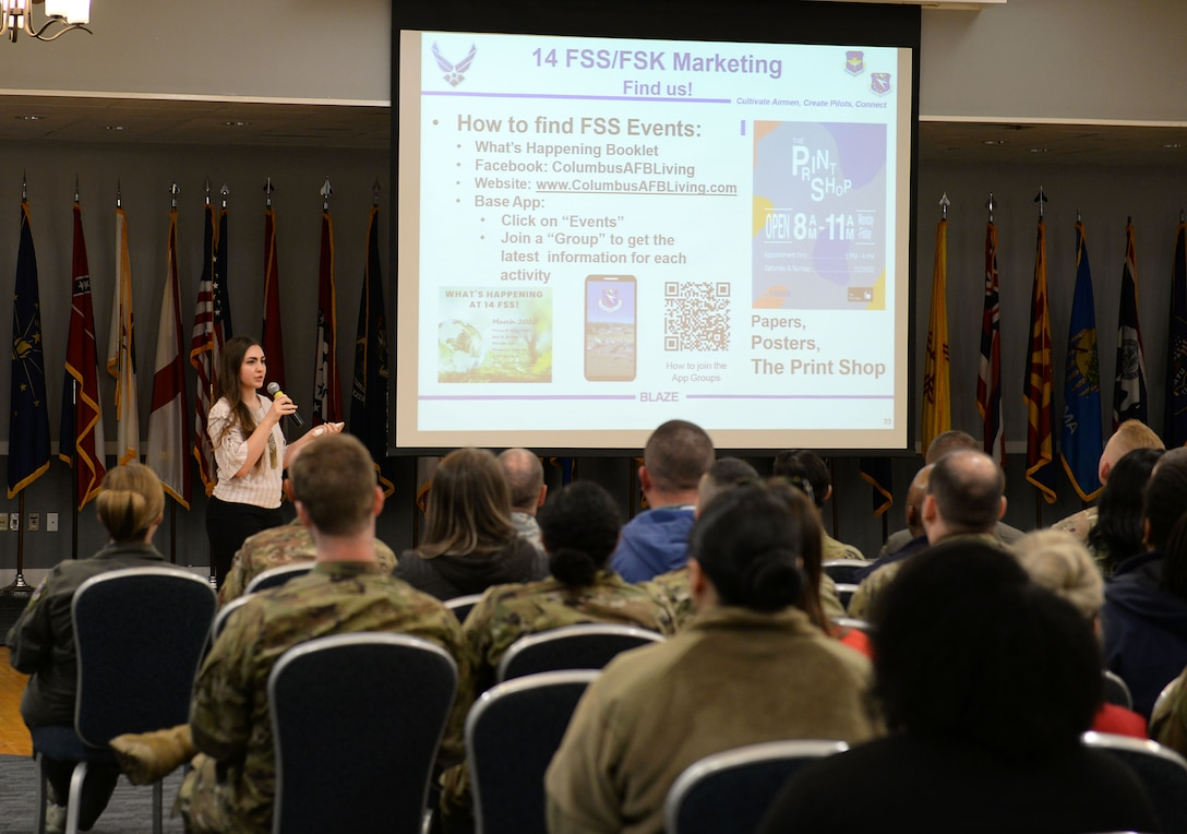 Rachel Buoni, 14th Force Support Squadron Visual Information specialist, briefs about where to find FSS events during the Quality of Life Town Hall March 5, 2020, at the Columbus Club on Columbus Air Force Base, Miss. Buoni showcased the various resources FSS Marketing utilizes to push out their information through and distribute. (U.S. Air Force photo by Airman Hannah 1st Class Bean)