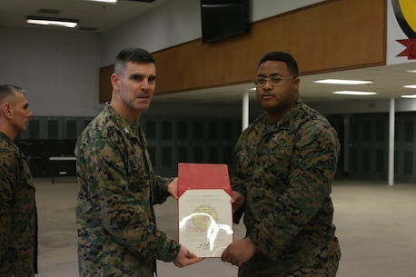 U.S. Marine Col. Donald J. Riley Jr., Commanding Officer for Chemical Biological Incident Response Force (CBIRF), poses with Petty Officer 3rd Class Malik Jones, a corpsman with CBIRF aboard Naval Support Facility Indian Head, Md., on March 4th, 2020. Petty Officer 3rd Class Jones was meritoriously promoted because he has proven himself to be above his peers. (Official U.S. Marine Corps photo by Lance Cpl. Blakely Graham/released)