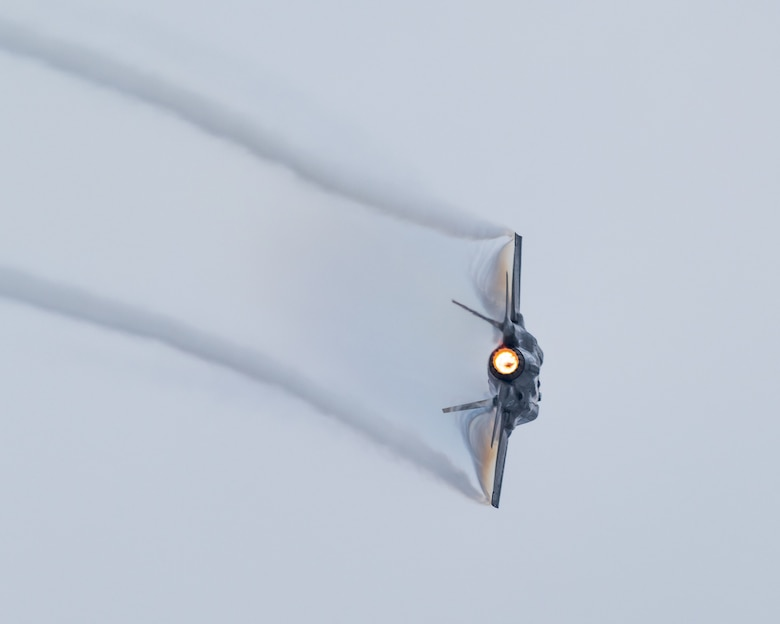 An F-35A Lightning II banking during a demonstration practice.