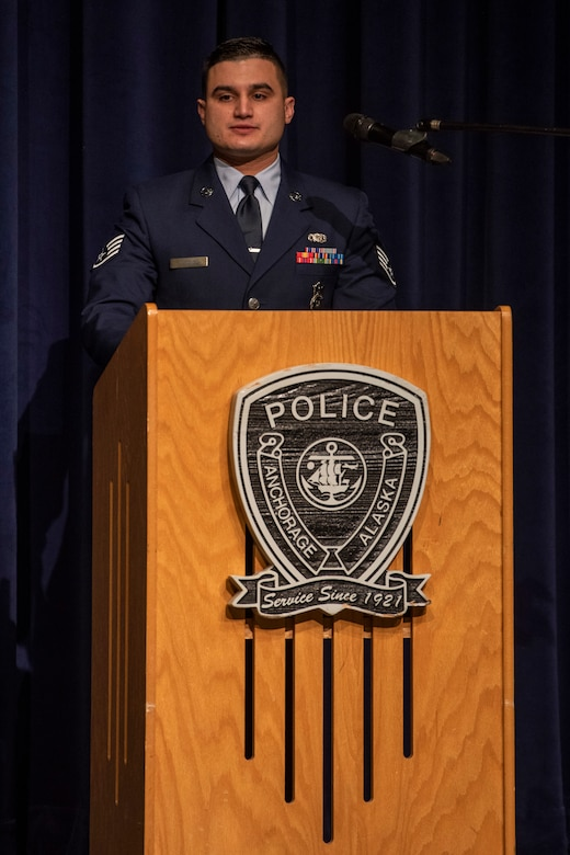 U.S. Air Force Staff Sgt. Ramses Alfonso, 673d Security Forces Squadron lead patrolman, speaks at his Anchorage Police Department 19-1 Academy graduation in Anchorage, Alaska, Dec. 5, 2019. When Alfonso was in fifth grade, he immigrated to the United States from Cuba and learned English. Alfonso earned the Distinguished Honor Graduate Award, Class Valedictorian, Top Shooter, and Top Defensive Driver in the Emergency Vehicle Operations Course. The partnership between the squadron and the Anchorage Police Department provides Airmen with a clearer understanding of municipal police procedures as well as builds contacts with all partner law enforcement agencies who participate in the academy.