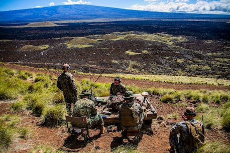 U.S. Marines with 3rd Marine Regiment and 1st Battalion, 12th Marine Regiment, communicate with aircraft during a tactical air control party at Pohakuloa Training Area, Hawaii, Feb. 26, 2020. Joint Terminal Attack Controllers conducted the exercise in order to better coordinate air support assets and calls for fire. (U.S. Marine Corps photo by Lance Cpl. Jacob Wilson)