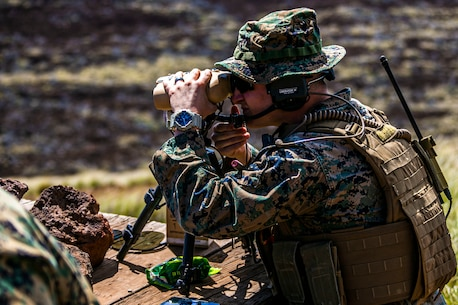 A U.S. Marine with 3rd Marine Regiment, 3rd Marine Division, locates his target downrange during a tactical air control party at Pohakuloa Training Area, Hawaii, Feb. 26, 2020. Joint terminal attack controllers conducted the exercise in order to better coordinate air support assets and calls for fire. (U.S. Marine Corps photo by Lance Cpl. Jacob Wilson)