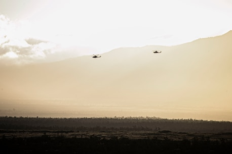 UH-1Y Venom and AH-1Z Viper helicopters maneuver towards a target in support of a tactical air control party at Pohakuloa Training Area, Hawaii, Feb. 26, 2020. Joint Terminal Attack Controllers conducted the exercise in order to better coordinate air support assets and calls for fire. (U.S. Marine Corps photo by Lance Cpl. Jacob Wilson)