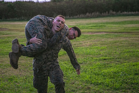 U.S. Marines with India Company, 3rd Battalion, 3rd Marine Regiment, conduct fireman carries during a company-level physical training event honoring Lance Cpl. William R. Prom on Marine Corps Base Hawaii, Feb. 10, 2020. Lance Cpl. Prom was with the unit when his actions in Vietnam during Operation Taylor Common were awarded with the Medal of Honor. (U.S. Marine Corps photo by Lance Cpl. Jacob Wilson)