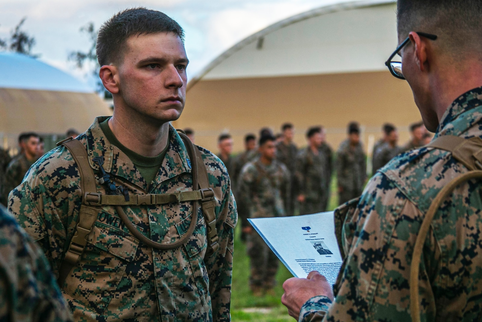 U.S. Marine Corps Sgt. Anthony Owen, squad leader, India Company, 3rd Battalion, 3rd Marine Regiment, is awarded the citation of Cpl. Robert E. O'Malley for outstanding service on Marine Corps Base Hawaii, Feb. 10, 2020. Cpl. O'Malley was with the unit when his actions in Vietnam during Operation Starlite were awarded with the Medal of Honor. (U.S. Marine Corps photo by Lance Cpl. Jacob Wilson)