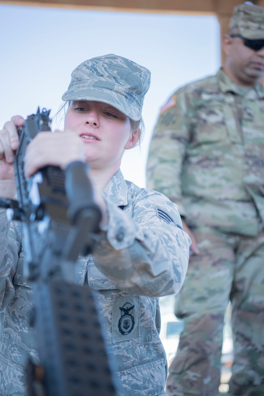 Senior Airman Sarah Lewis, a member of the 149th Security Forces Squadron, reassembles an M249 light machine gun during the Texas Military Department's 2020 Best Warrior Competition March 7, 2020, at Camp Swift, Texas.