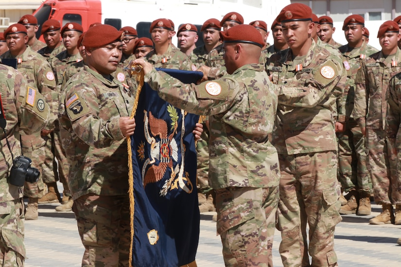 Lt. Col. David Santos, commander of the 1st Battalion, 294th Infantry Regiment, Guam National Guard, and Command Sgt. Maj. Kenneth Cruz, the 1-294th senior enlisted advisor, case the units colors during a transfer of authority ceremony on South Camp, in Sharm el-Sheikh, Egypt, March 8, 2020. For the past 9 months, the 1-294th have served as the 66th rotational U.S. Army unit in support of the MFO peacekeeping mission.