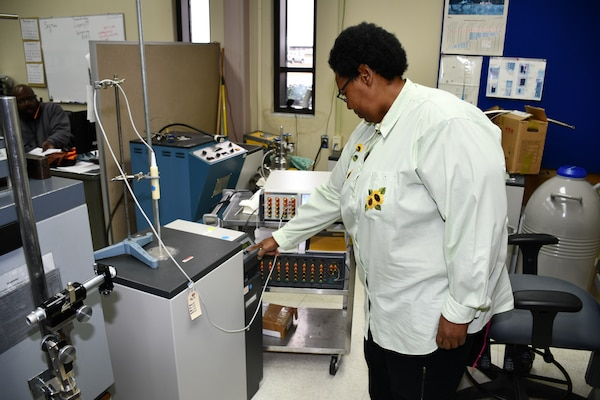 Cheryl Brown, Reference Standards Laboratory Technician for the Mid-Atlantic Regional Calibration Center, adjusts a freeze point furnace while performing a Platinum Resistance Thermometer calibration for Shop 33.