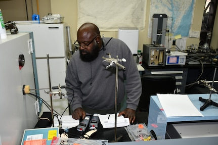 Willie Rhodes, Reference Standards Laboratory Technician for the Mid-Atlantic Regional Calibration Center, performs DM70 Dew Point Meter calibration for Shop 26.
