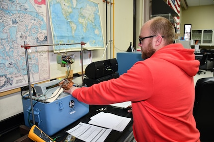 Chris Gorton, Instrument Mechanic for the Mid-Atlantic Regional Calibration Center, performing a temperature switch calibration for USS Kearsage (LHD 3) in direct support of fleet readiness.