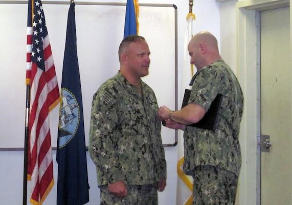Rear admiral presents award