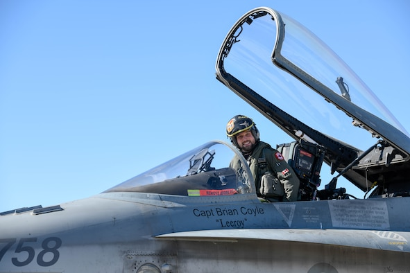 A Royal Canadian air force CF-18 Hornet pilot, assigned to the 433rd Tactical Fighter Squadron in Canadian Forces Base Bagotville, Quebec, Canada, poses for a photo Feb. 25, 2020, at Luke Air Force Base, Ariz.
