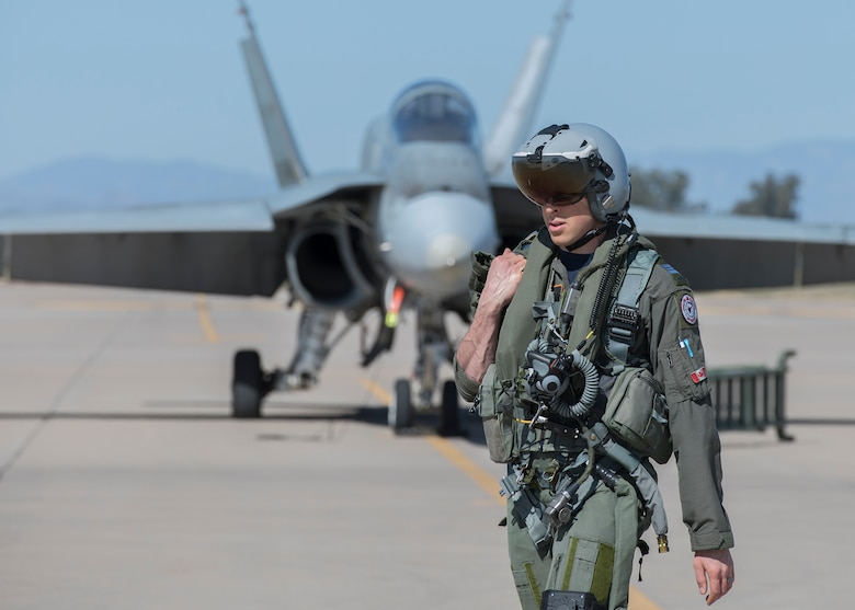 A Royal Canadian air force CF-18 Hornet pilot, assigned to the 433rd Tactical Fighter Squadron in Canadian Forces Base Bagotville, Quebec, Canada, prepares for a flight Feb. 25, 2020, at Luke Air Force Base, Ariz.