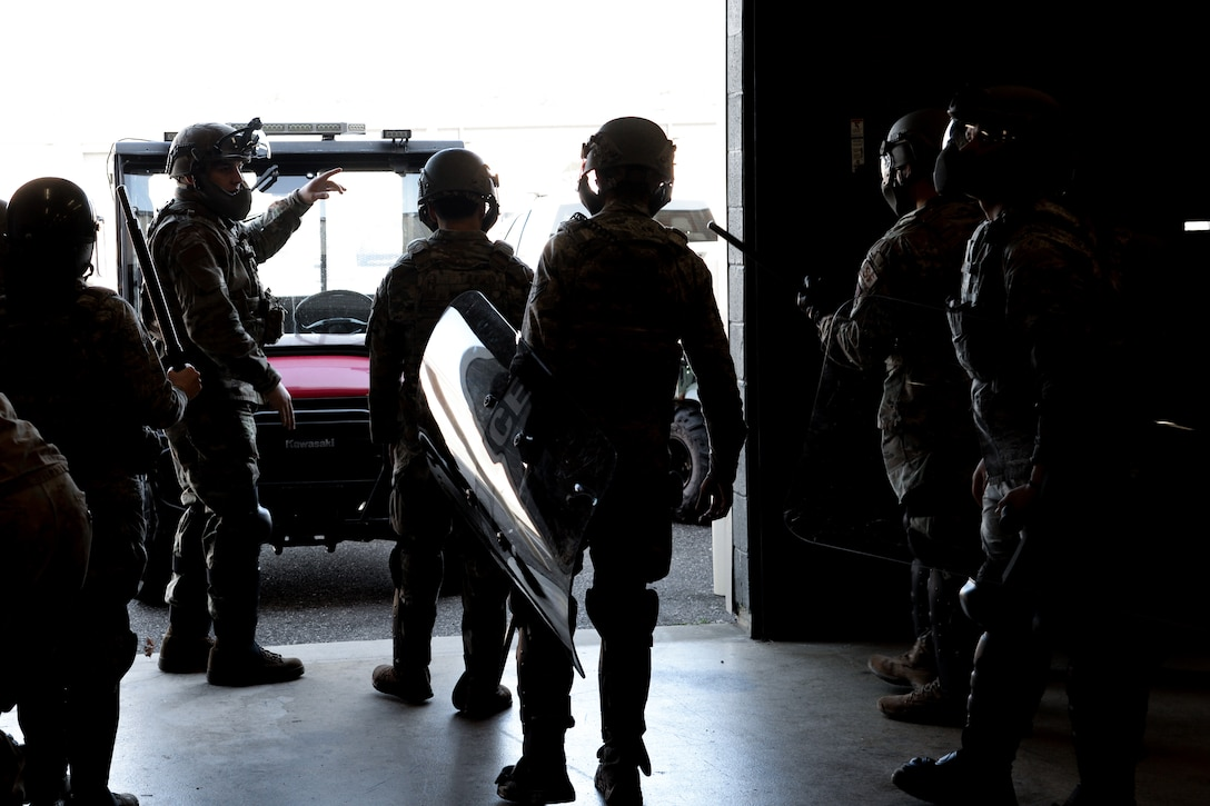 A picture of Airmen standing in riot gear.