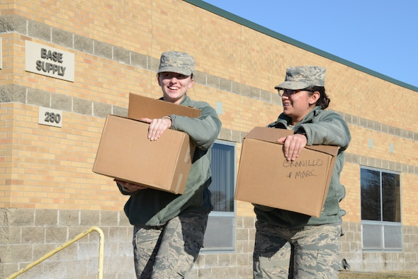 Airmen pick up their initial issue of the new Air Force Operational Camouflage Uniform in Sioux City, Iowa