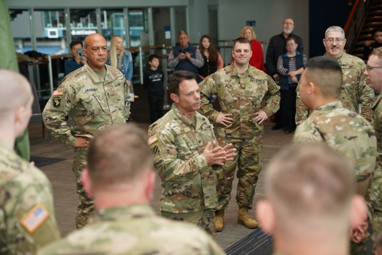 U.S. Army Reserve Col. Vince Rice, deputy commander of 364th Sustainment Command (Expeditionary), speaks with Detachment 1 Soldiers, following a send-off ceremony at CenturyLink Field Center, March 6, 2020. Approximately 50 U.S. Army Reserve Soldiers of DET 1, 654th RSG Headquarters, will deploy to the Middle East in support of Operation Spartan Shield, providing base life support for units rotating through the United States Central Command area of operation. The 654th RSG, headquartered in Tacoma, Washington, deploys to provide base camp sustainment and area security in support of unified land operations. (Photo by U.S. Army Reserve Sgt. Christian Dizon, Unit Public Affairs Representative, 477th Transportation Company)