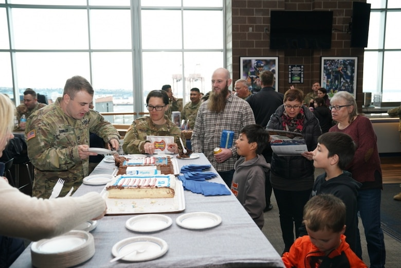 Family and friends gathered to bid farewell to approximately 50 U.S. Army Reserve Soldiers of Detachment 1, 654th Regional Support Group, 364th Sustainment Command (Expeditionary), at a send-off ceremony at CenturyLink Field Event Center, March 6, 2020. DET 1, led by Maj. Thomas Boler, a native of Vancouver, Washington, will deploy to the Middle East in support of Operation Spartan Shield, providing base life support for units rotating through the United States Central Command area of operation. The 654th RSG, headquartered in Tacoma, Washington, deploys to provide base camp sustainment and area security in support of unified land operations. (Photo by U.S. Army Reserve Sgt. Christian Dizon, Unit Public Affairs Representative, 477th Transportation Company)