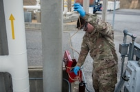 U.S. Air Force Staff Sgt. Anthony DiTonno, 633rd Logistics Readiness Squadron Fuels Laboratory non-commissioned officer in-charge, tests fuel as it is delivered at Joint Base Langley-Eustis, Virginia, March 10, 2020. The fuel is tested to ensure the product meets or exceeds quality standards. (U.S. Air Force photo by Airman 1st Class Sarah Dowe)