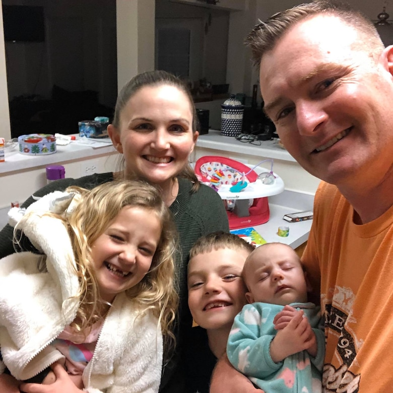 A family gathers for a selfie