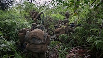 U.S. Marines with Kilo Company, 3rd Battalion, 3rd Marine Regiment make their way through the jungle terrain during a squad patrol at Schofield Barracks, Hawaii, Feb. 25, 2020. Bougainville I is the beginning exercise that focus on squad level battle drills and tactical training aiming to strengthen the units pre-deployment readiness. (U.S. Marine Corps photo by Cpl. Eric Tso)