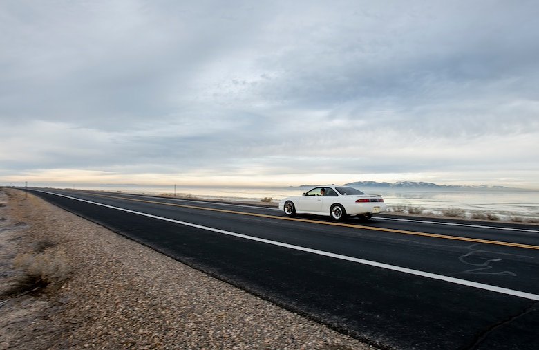 U.S. Air Force Staff Sgt. Brandon Bunn, a 388th Maintenance Group quality assurance inspector and car enthusiast, drives to Antelope Island, Utah, Feb. 2, 2020. On his off-time, Bunn turns wrenches on his 1998 Nissan 240SX drag car. He uses the car as a learning opportunity to teach his daughters about cars and carry on the family hobby. (U.S. Air Force photo by Staff Sgt. Jarrod M. Vickers)