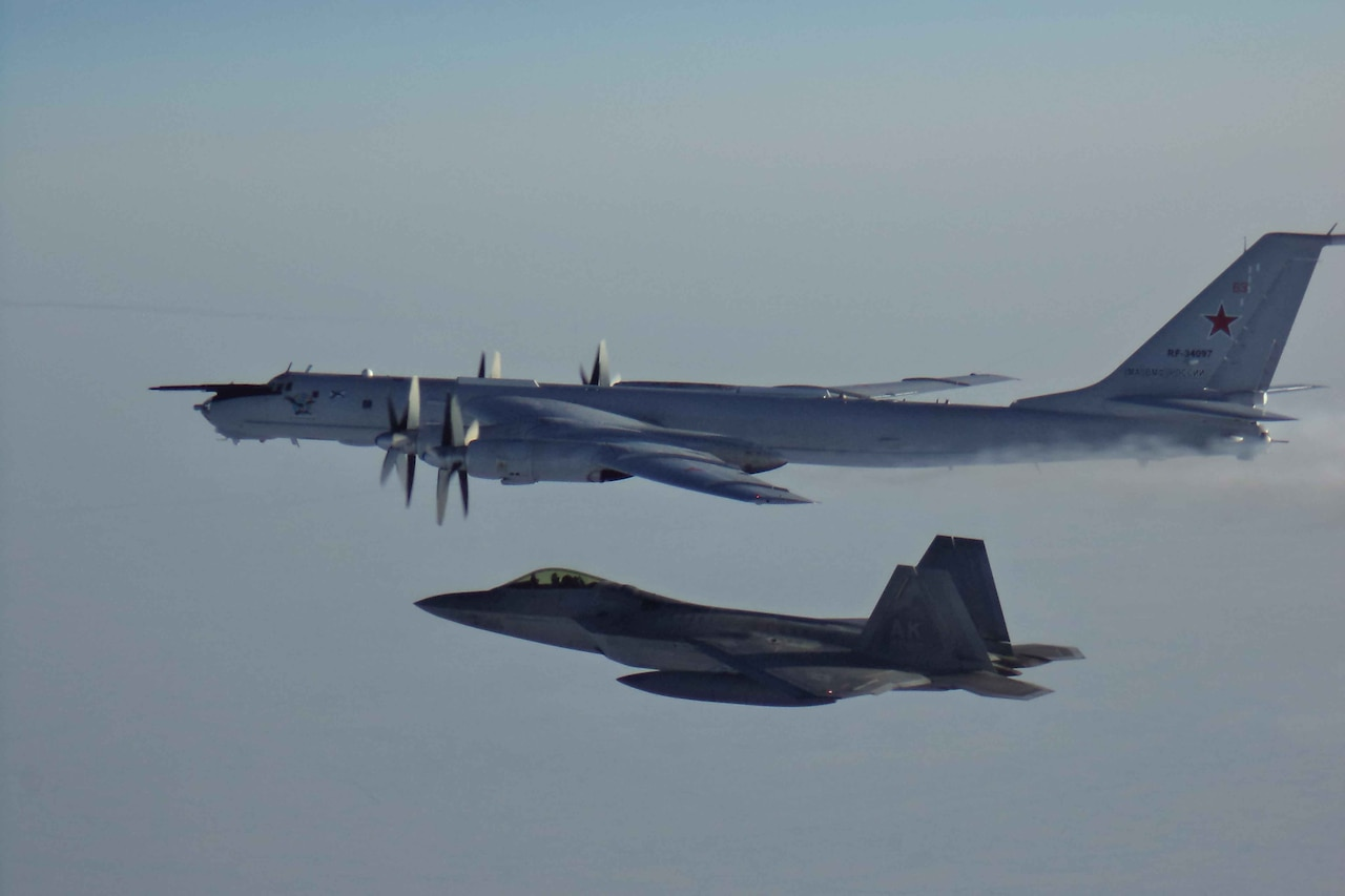 U.S. F-22 escorts Russian aircraft.