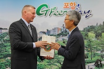 Maj. Gen. Bradley S. James gives a gift to Pohang Vice Mayor Song Kyeong Change, on the behalf of U.S. Marine Corps Forces Korea. The two gentlemen met to discuss the future relationship and unity between the City and U.S. Marines. (U.S. Marine Corps Photo by Sgt. Parker R. Golz)