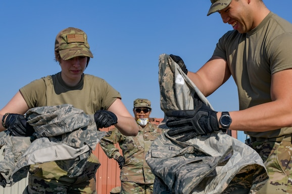 Airmen seperating uniform items