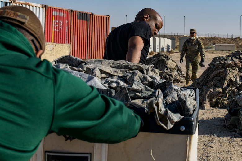 Airmen seperating uniform items