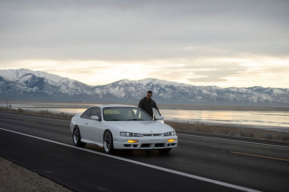Staff Sgt. Brandon Bunn, a 388th Maintenance Group quality assurance inspector and car enthusiast, gets in his 1998 Nissan 240SX on Antelope Island, Utah, Feb. 2, 2020. His 240SX has a 2JZ-GTE engine from the fourth-generation Toyota Supra and gets more than 500 horsepower to the wheels, reliably. (U.S. Air Force photo by Staff Sgt. Jarrod M. Vickers)