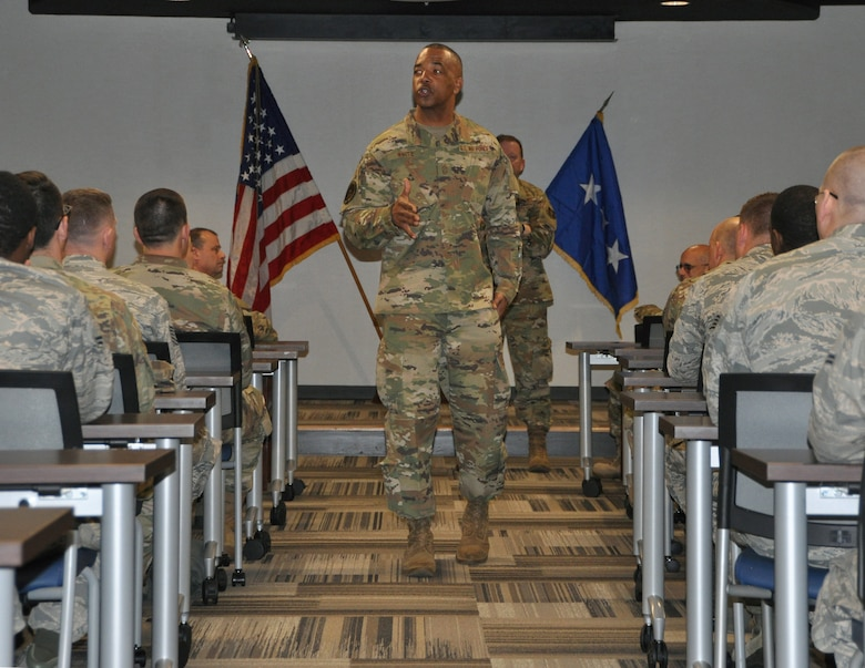 In this commentary, Chief Master Sgt. Timothy White Jr., AFRC's command chief master sergeant (shown here talking to Reservists from the 908th Airlift Wing, Maxwell Air Force Base, Alabama) addresses the importance of taking care of each other during these dynamic times.  (Bradley J. Clark)