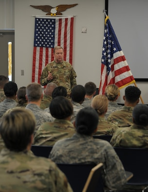 In this commentary, Lt. Gen. Richard Scobee, commander of Air Force Reserve Command (shown here talking with members of the 908th Airlift Wing, Maxwell Air Force Base, Alabama) lays out the command's plan for helping the country respond to COVID-19. (Senior Airman Shelby Thurman)