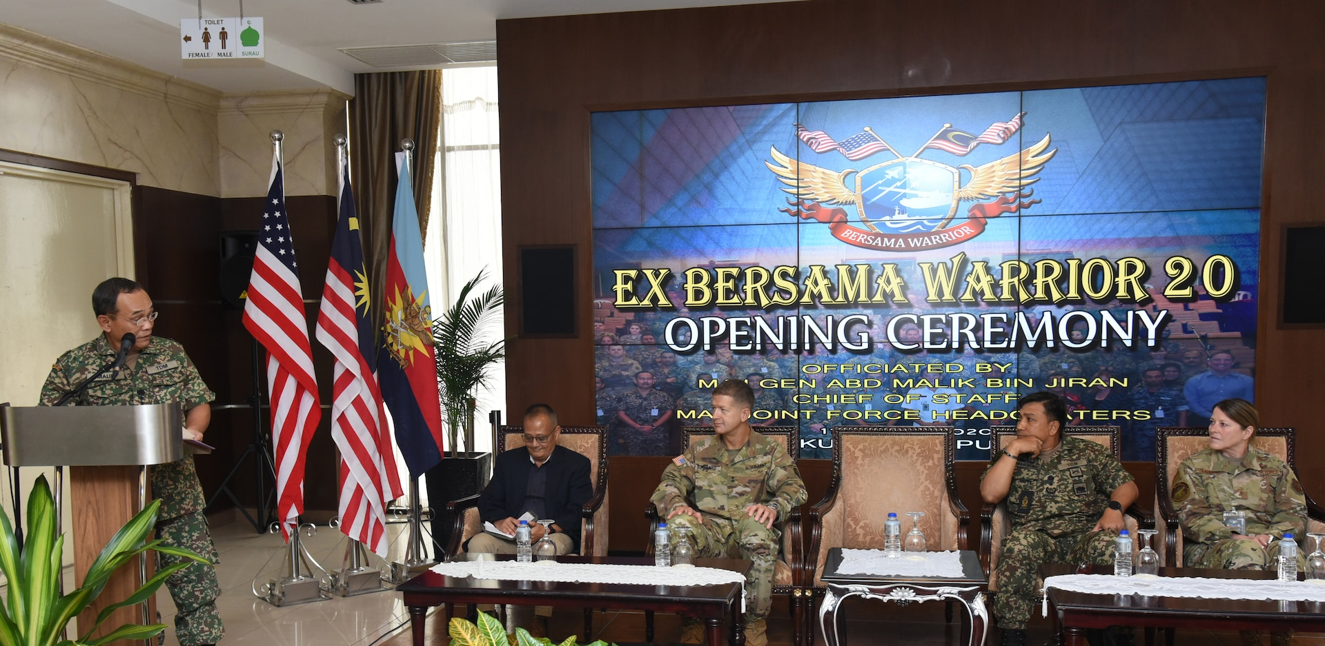 Malaysia Armed Forces Joint Force Headquarters Chief of Staff Maj. Gen. Abd Malik bin Jiran officiates the opening ceremony of Bersama Warrior March 11, 2020, at the Malaysia Armed Forces Joint Force Headquarters in Kuala Lumpur. Also pictured, left to right, is U.S. Army U.S. Indo-Pacific Command, Pacific Warfighting Center Director Paul Tamaribuchi; 25th Infantry Division Commander Maj.Gen.James B. Jarrard; 12th Malaysian Infantry Brigade Commander Brig. Gen. Datuk Marzuki bin HJ Mokhtar; and Special Assistant to the Director of the Air National Guard Brig. Gen. Jill A. Lannan.