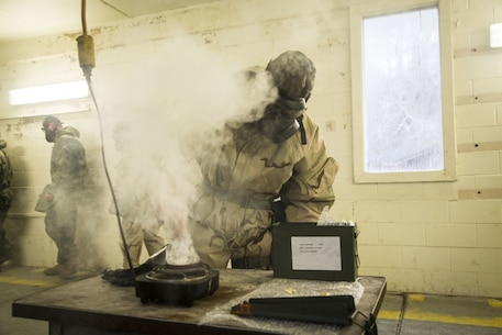 Lance Cpl. James Fyffe, a Chemical, biological, radiological, and nuclear Defense specialist with the 24th Marine Expeditionary unit, breaks chlorobenzalmalononitrile capsules during gas chamber training on Camp Lejeune, North Carolina, February 14, 2020. Marines participate in this training to stay proficient with their mask in case they are exposed to a contaminated environment. (U.S. Marine Corps photo by Cpl. Margaret Gale)