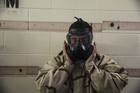Corporal Heriberto Nunez, an administrative specialist with the 24th Marine Expeditionary Unit, clears his M50 Joint Service General Purpose Mask during the Individual Protective Equipment Confidence Exercise on Camp Lejeune, North Carolina, February 14, 2020. Marines participate in this training to stay proficient with their mask in case they are exposed to a contaminated environment. (U.S. Marine Corps photo by Cpl. Margaret Gale)