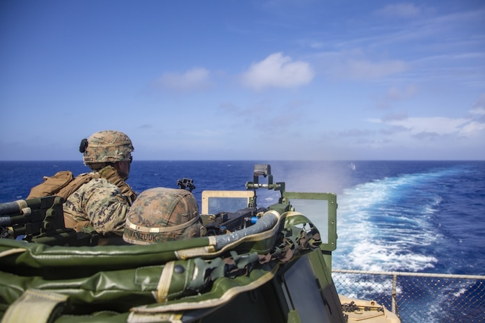 PACIFIC OCEAN (March 3, 2020) Sgt. Raymond Ramirez, a section leader, supervises Lance Cpl. Jerry Vanzuuk, an assault man, both with Battalion Landing Team, 1st Battalion, 5th Marines, 31st Marine Expeditionary Unit (MEU), while conducting a mounted machine gun range on a Joint Light Tactical Vehicle aboard the Whidbey Island-class dock landing ship USS Germantown. Germantown, part of the America Expeditionary Strike Group, 31st MEU team, is operating in the U.S. 7th Fleet area of operations to enhance interoperability with allies and partners and serve as a ready response force to defend peace and stability in the Indo-Pacific region. (Official U.S. Marine Corps photo by Lance Cpl. Joshua Sechser)