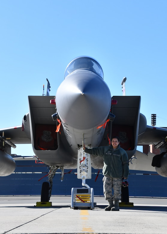 Master Sgt. Marilyn Morales, 104th Maintenance Group avionics flightline technician, stands with an F-15 Eagle she has worked on March, 7, 2020, at Barnes Air National Guard Base, Massachusetts. Morales is a First Segreant on drill weekends and an avionics flightline technician during the week. (U.S. National Guard video by Airman Basic Sara Kolinski)